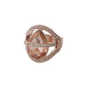 Rose gold tone stretch ring with clear rhinestones.