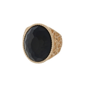Gold tone stretch ring with a faceted black stone focal.