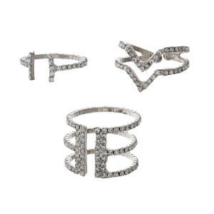 Silver tone, flexible ring set with clear rhinestones. Each ring flexes to fit most sizes.