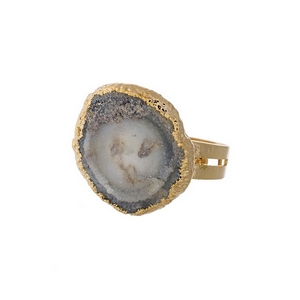 Gold tone adjustable ring featuring a gray natural stone.