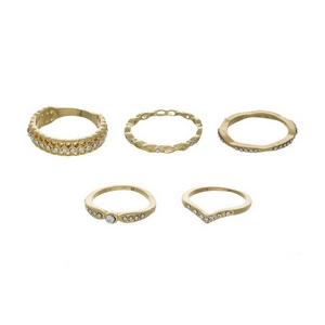 Five piece gold tone ring set with clear rhinestones. All rings are one size and not adjustable. Approximately size 7.