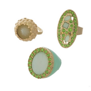 Three piece gold tone ring set featuring mint green stones. All rings approximately a size 7.