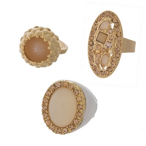 Three piece gold tone ring set featuring blush stones. All rings approximately a size 7.