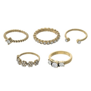 Gold tone, five piece ring set. All rings are one size, approximately a size 7.