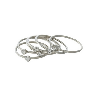 Dainty silver tone, six piece ring set with clear rhinestones on each. All rings approximately a size 7 and cannot be adjusted.
