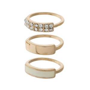 Gold tone, three piece ring set with clear rhinestones. All three rings are approximately a size 6 and cannot be adjusted.