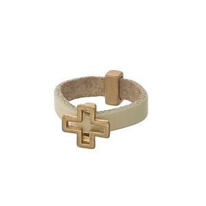 Ivory, genuine leather ring with a gold tone cross. Ring is a size 7.