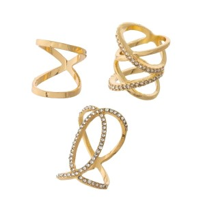Three piece gold tone ring set with a criss-cross pattern and clear rhinestones. All three rings are approximately a size 7 and are not adjustable.
