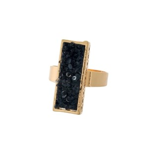 Gold tone ring with a black faux druzy stone.