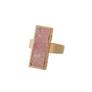 Gold tone ring with a pink faux druzy stone. Adjustable in size.