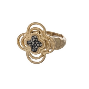 Gold tone stretch ring with a clover focal, accented with crush hematite stones.