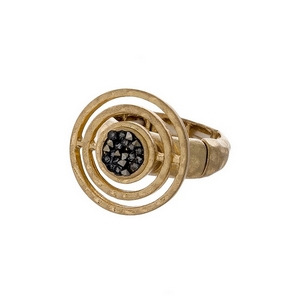 Gold tone stretch ring with a circle focal, accented with crush hematite stones.