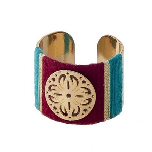 Gold tone ring with maroon and teal thread wrapping details. Adjustable in size.