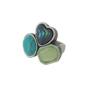 Silver tone cocktail ring with abalone, mint green, and turquoise stones. Approximately a size 7 and does not adjust.