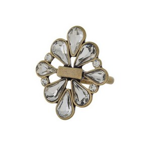 Burnished gold tone ring with clear rhinestones. Adjustable in size.