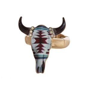 Metal stretch ring with a tribal print steer head.