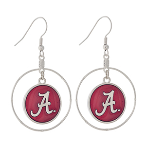 """Silver tone fishhook earrings displaying a ring with a dangling officially licensed crimson University of Alabama charm. Charm approximately 1 1/2"""" in length. Overall length 2 1/8""""."""