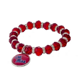 Officially licensed, Ole Miss stretch bracelet with clear rhinestone accents and a logo charm.
