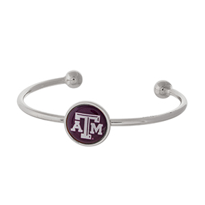 Officially licensed, silver tone cuff bracelet with the Texas A&M University logo.