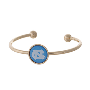 Officially licensed, gold tone cuff bracelet with the University of North Carolina logo.
