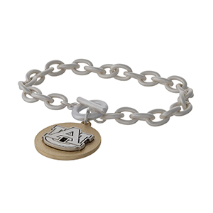 Officially licensed, two tone toggle bracelet with the Auburn University logo charm.